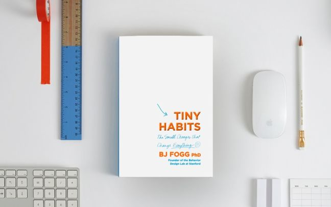 A copy of Tiny Habits surrounded by stationery
