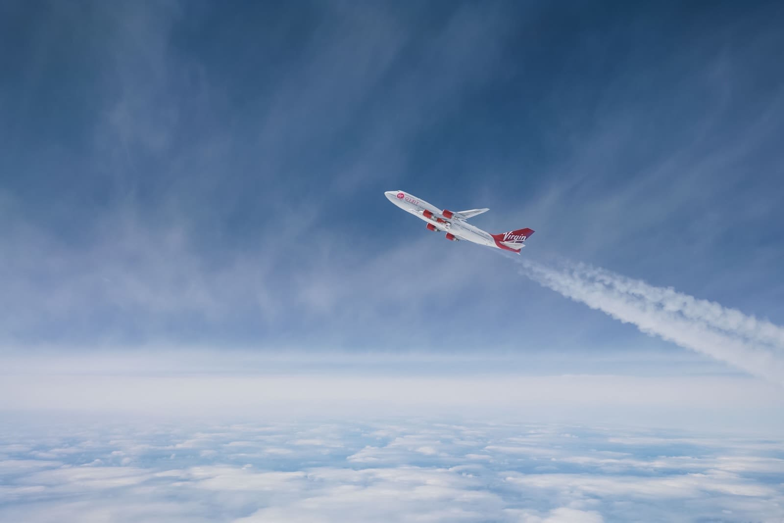 Virgin Orbit's adapted Boeing 747 Cosmic Girl taking off through the skies