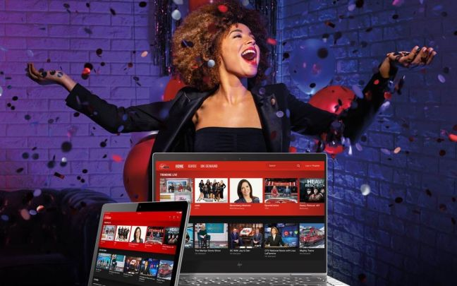 A woman celebrates the launch of Virgin TV