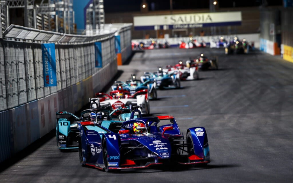 Envision Virgin Racing car at the front of a line of Formula E racing cars
