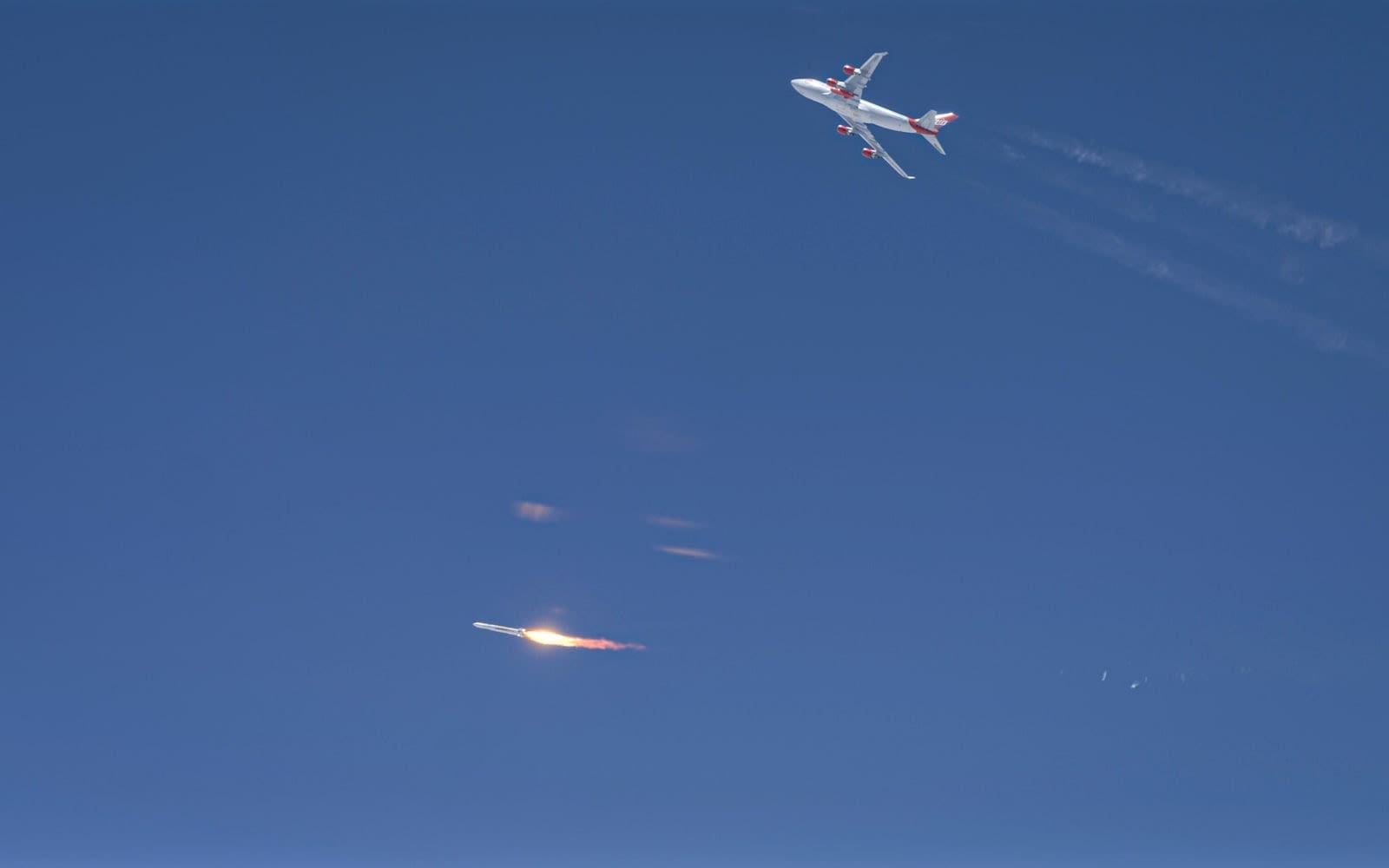 Virgin Orbit LauncherOne ignites, Boeing 747 Cosmic Girl is seen in the background