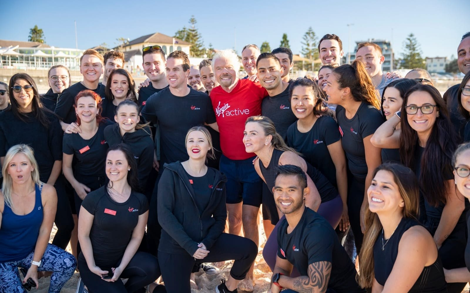 Richard Branson with the team from Virgin Active Australia on Bondi Beach