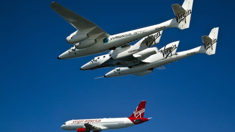 Virgin Galactic's SpaceShip Two flying alongside Virgin Orbit's Cosmic Girl