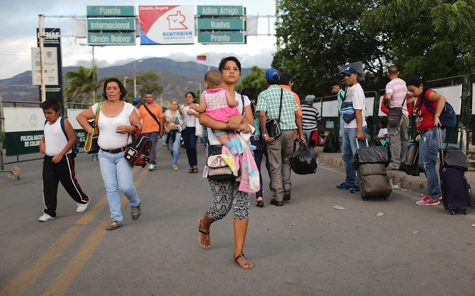 Woman walking with her child on road in Venezuela