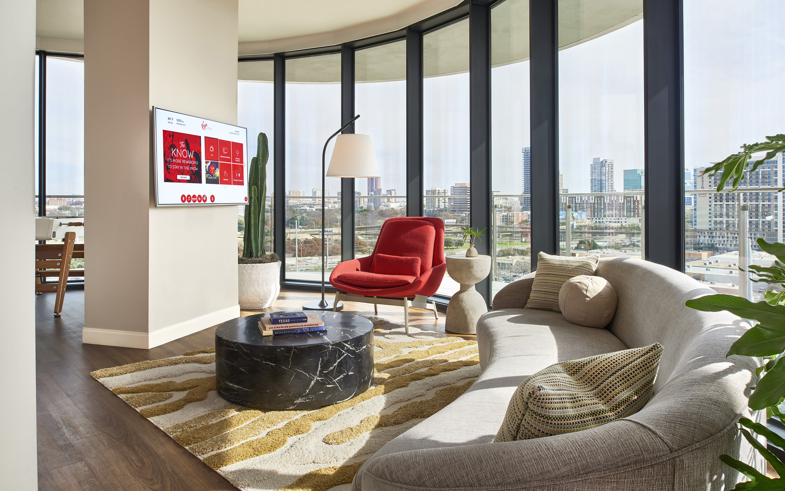 The TV and SMEG fridge in a Chamber at Virgin Hotels Dallas