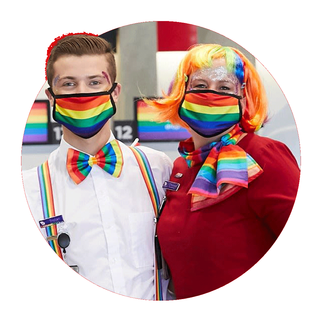 Two Virgin Australia crew members in rainbow coloured face masks and ties.