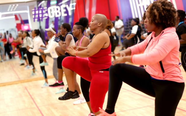 Women workout in a studio at the first Virgin Active club in Botswana