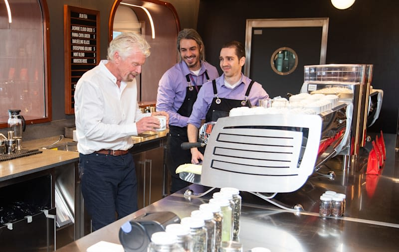 Richard Branson having a cup of tea with the Virgin Voyages crew