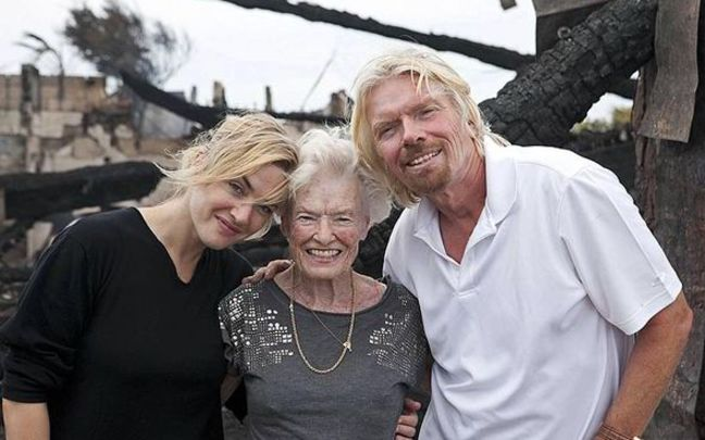 Richard Branson, Eve Branson and Kate Winslet stand in the ruins of a fire on Necker Island in 2011