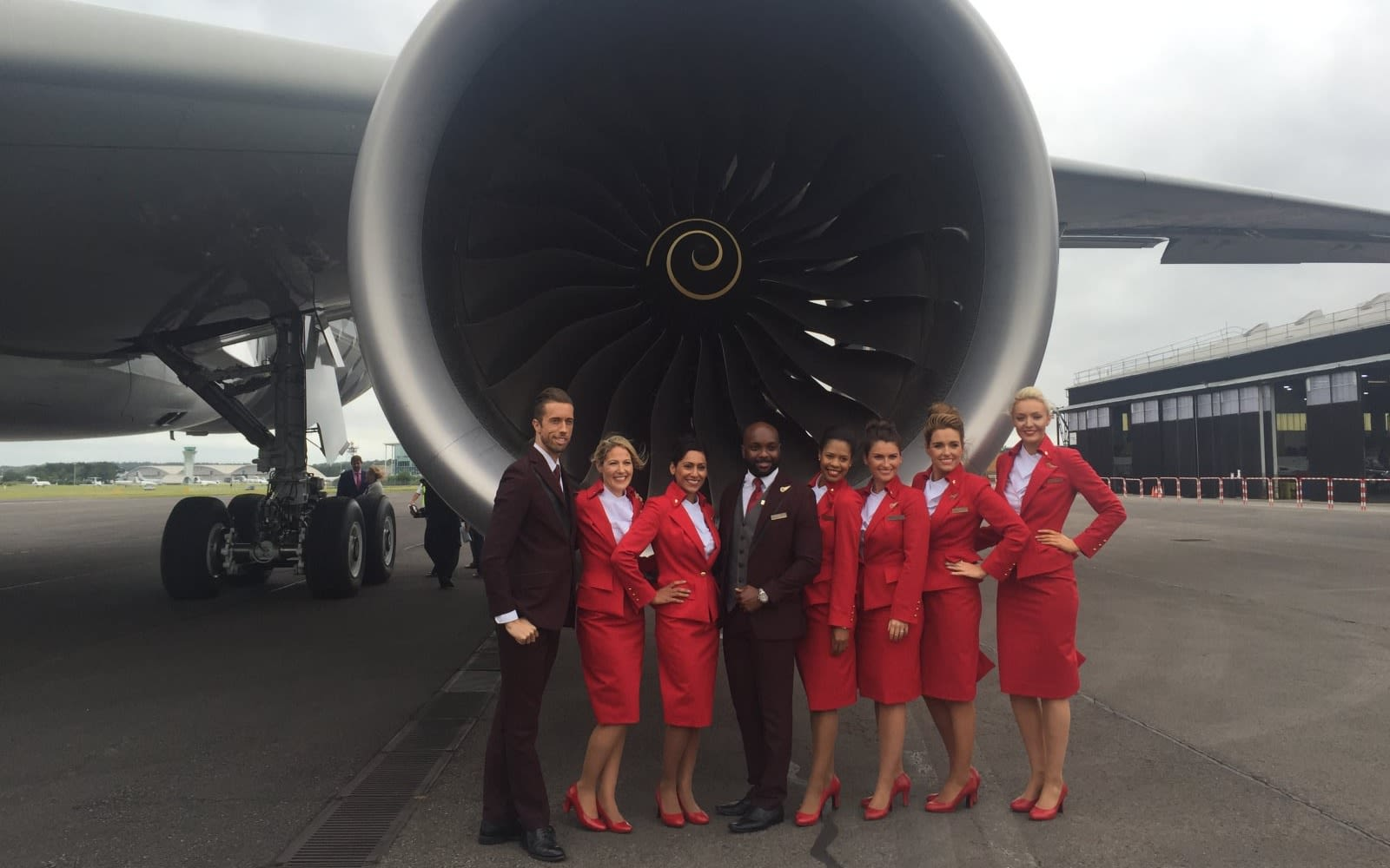 Cabin crew members standing beside an aircraft