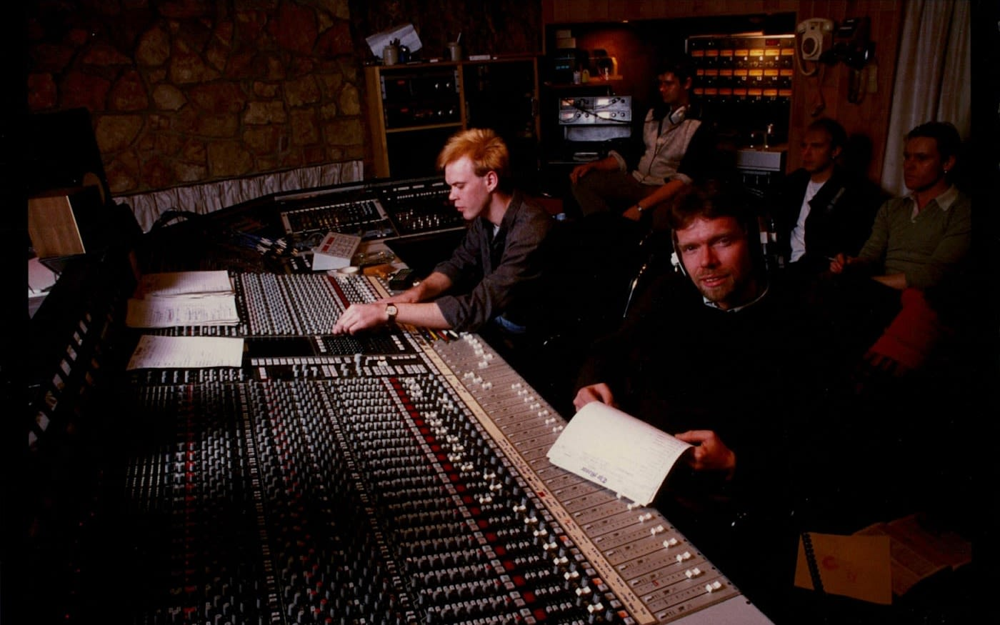 A young Richard Branson sitting in a recording studio at Virgin Records