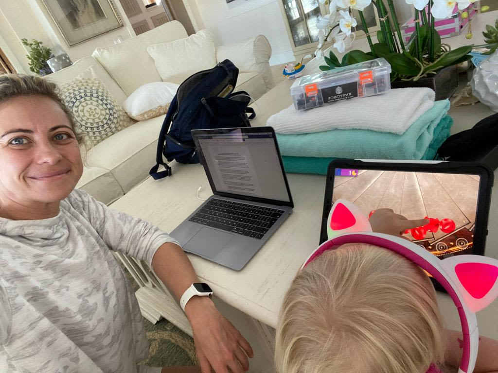 Holly Branson remote working with her daughter Lola