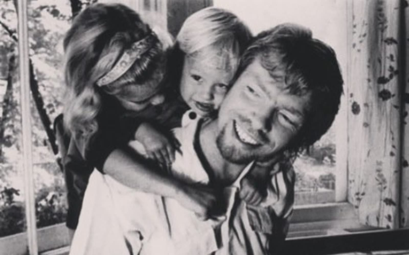 A young Richard Branson with Sam and Holly Branson as children on his back