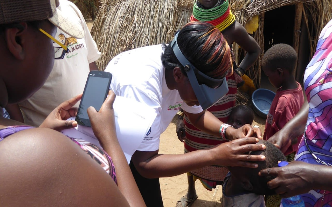 Sightsavers team member checking a childs eyes