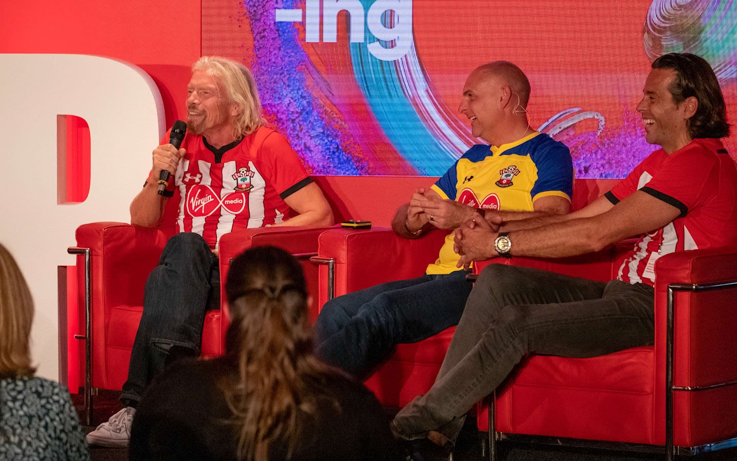 Richard Branson speaking on a Virgin Media panel with the Southampton football team