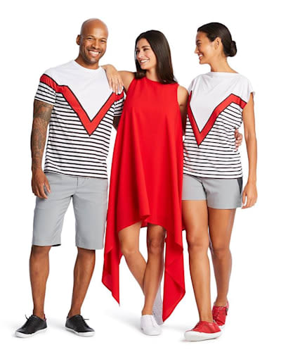 A man and two women model the  Virgin Voyages uniform