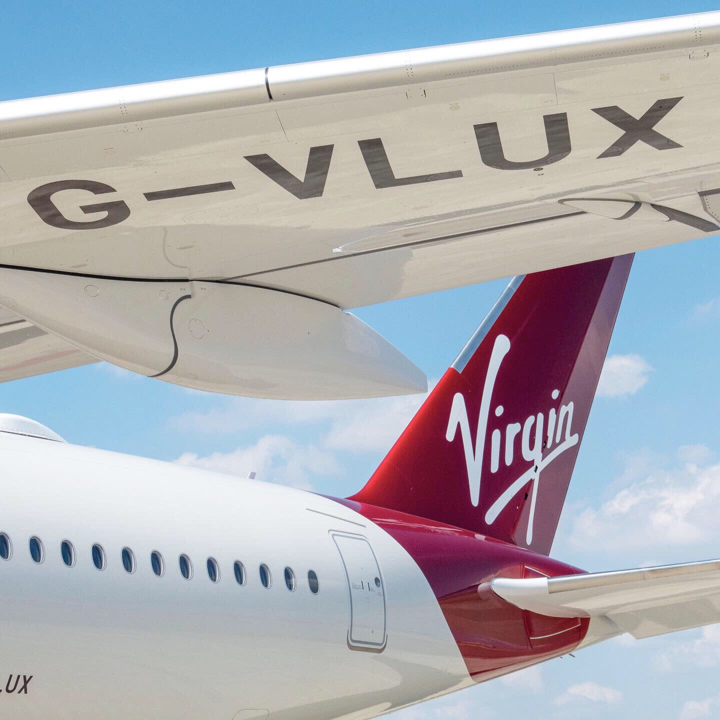 The tail fin and underwing of Virgin Atlantic's Airbus A350 G-VLUX