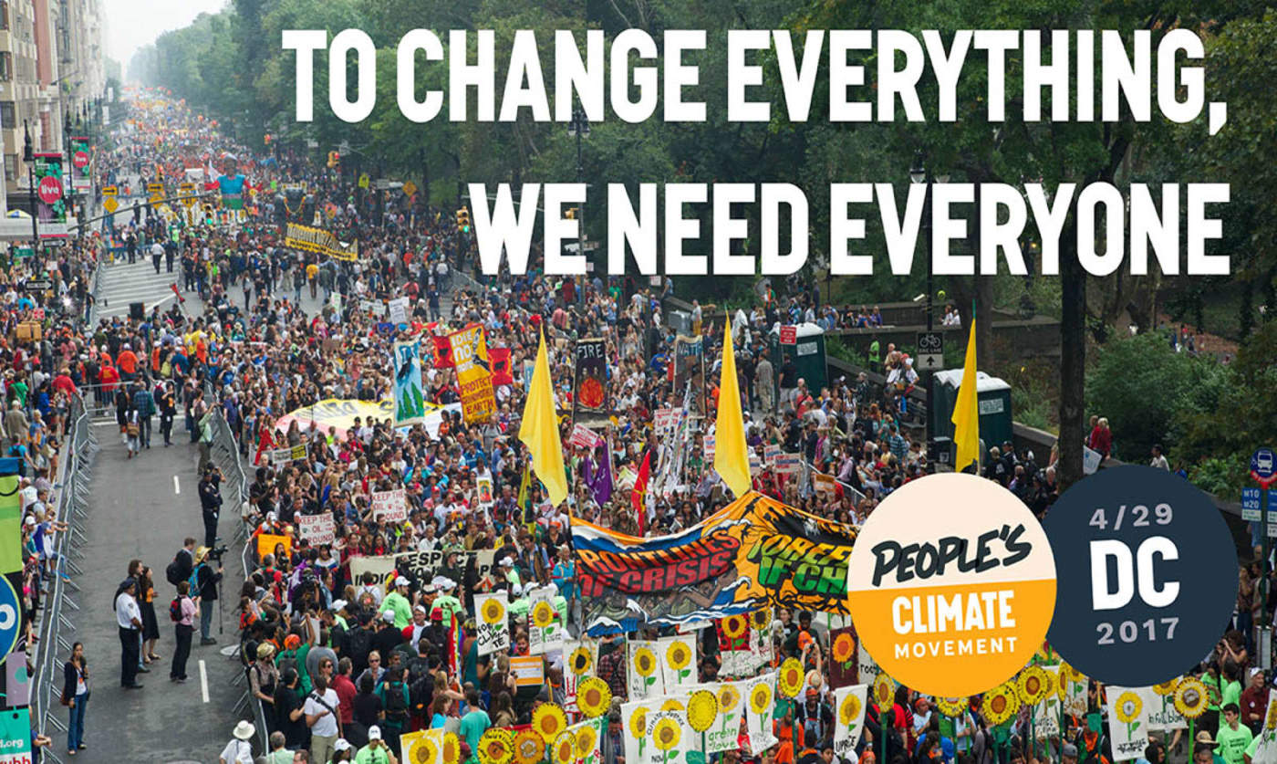 "Photo of the climate march with white text over it that reads ""To change everything, we need everyone"""