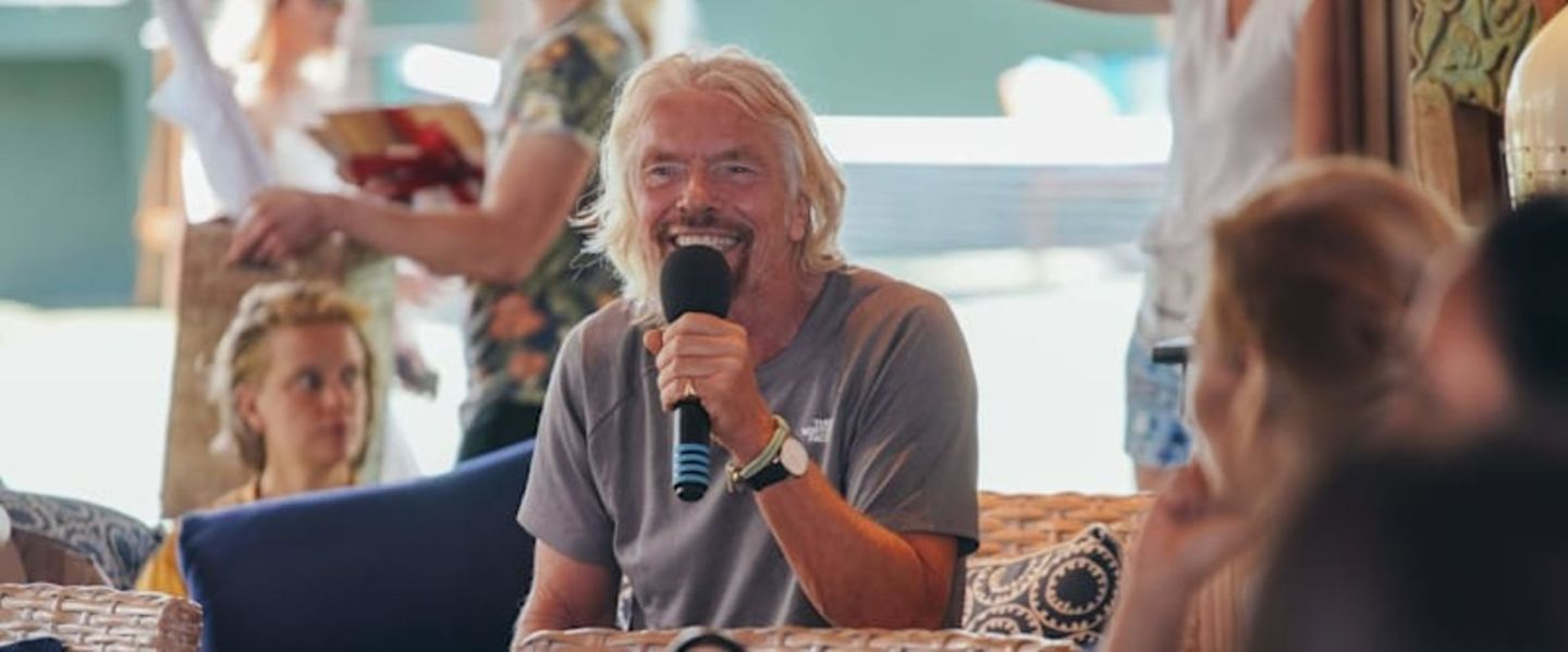 Richard Branson smiling while speaking at a Virgin Unite event