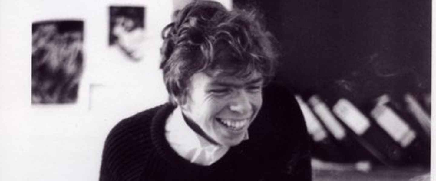 Black and white photo of a young Richard Branson smiling
