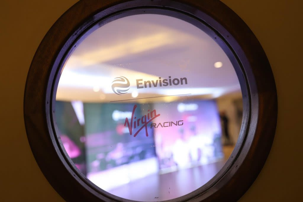 Envision Virgin Racing logo on a round window