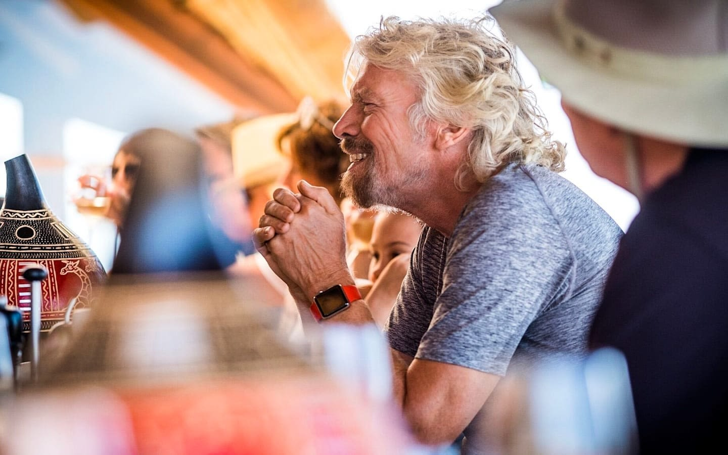 Richard Branson smiling in a meeting at Ulusaba in South Africa 2016