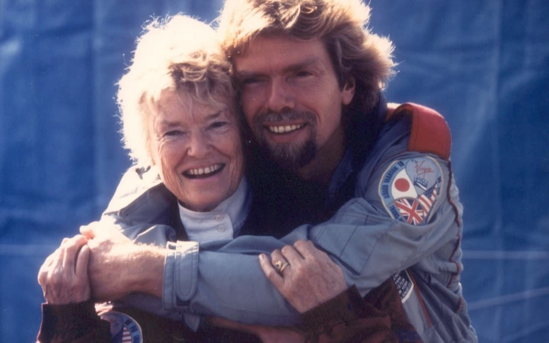 Richard Branson hugging Eve Branson ahead of a hot air ballooning expedition
