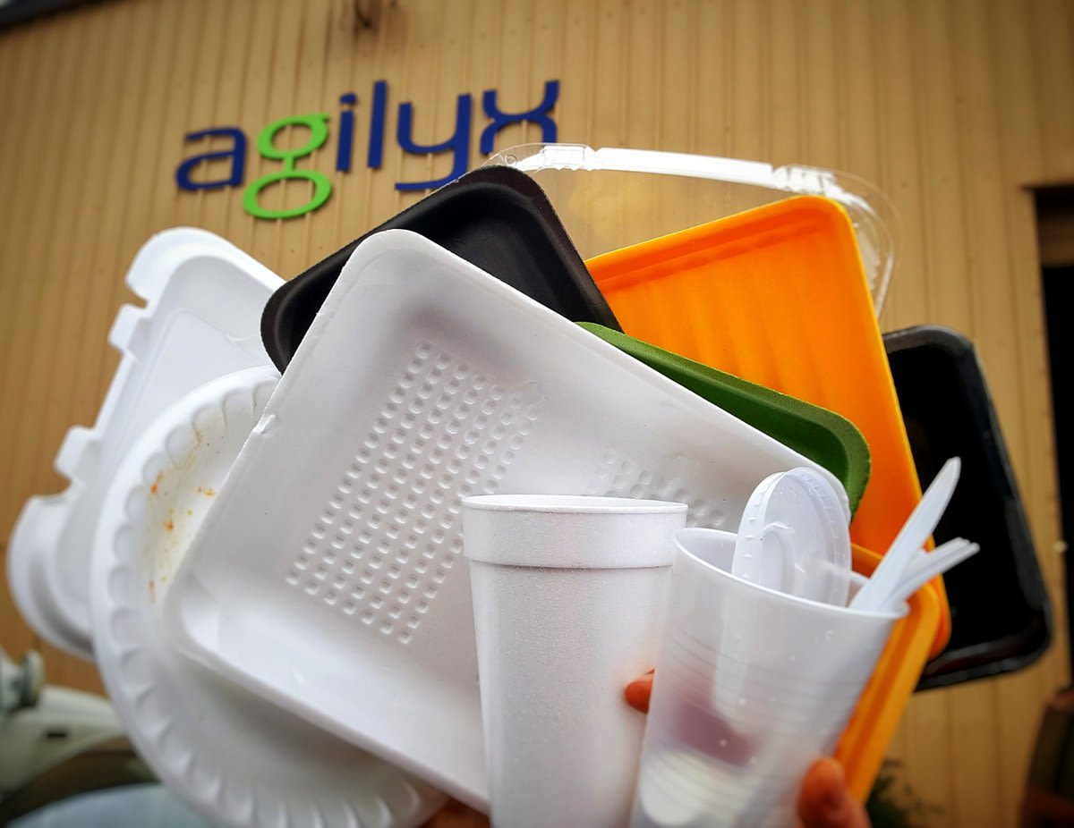 Plastic rubbish pictured in front of an agilyx sign