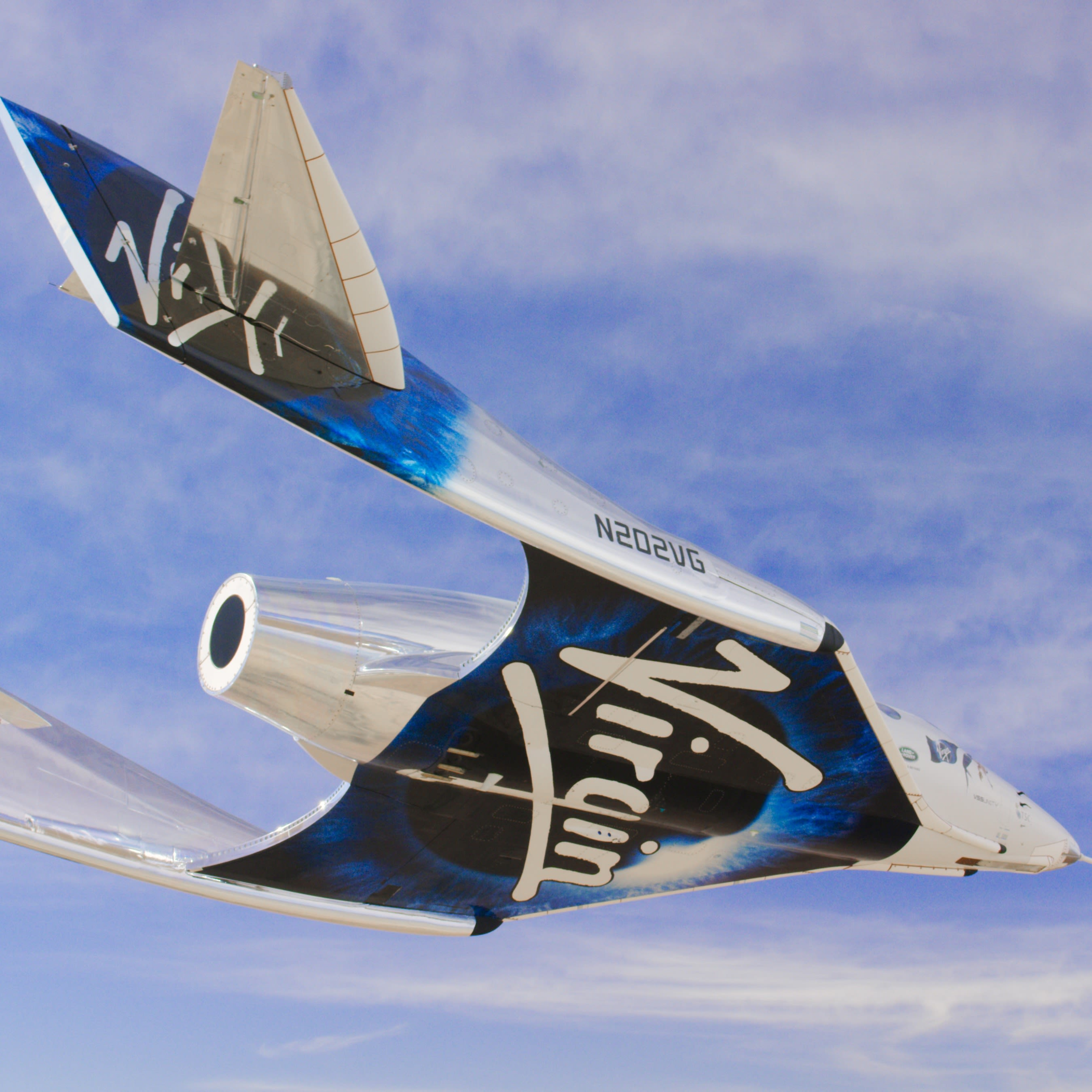 Virgin Galatic's SpaceshipTwo glides through the sky
