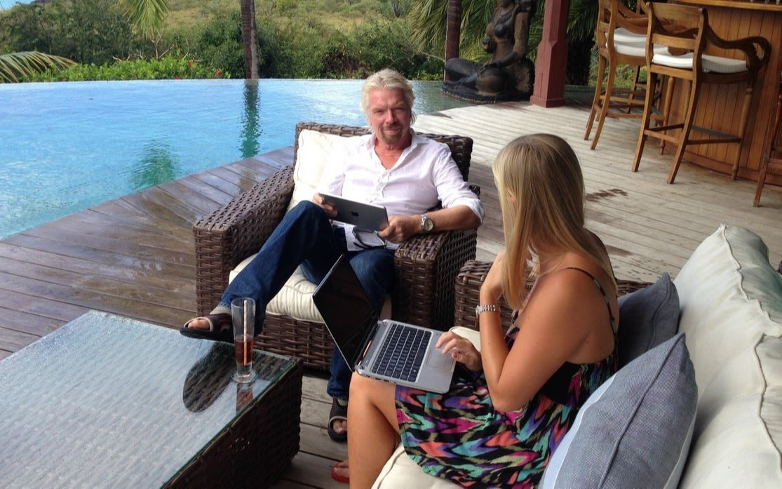 Richard Branson with his assistant working on Necker