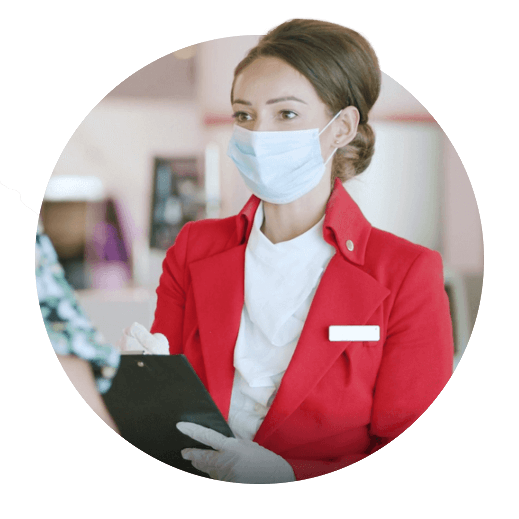 Virgin Atlantic ground crew member wearing PPE mask and chatting to a customer