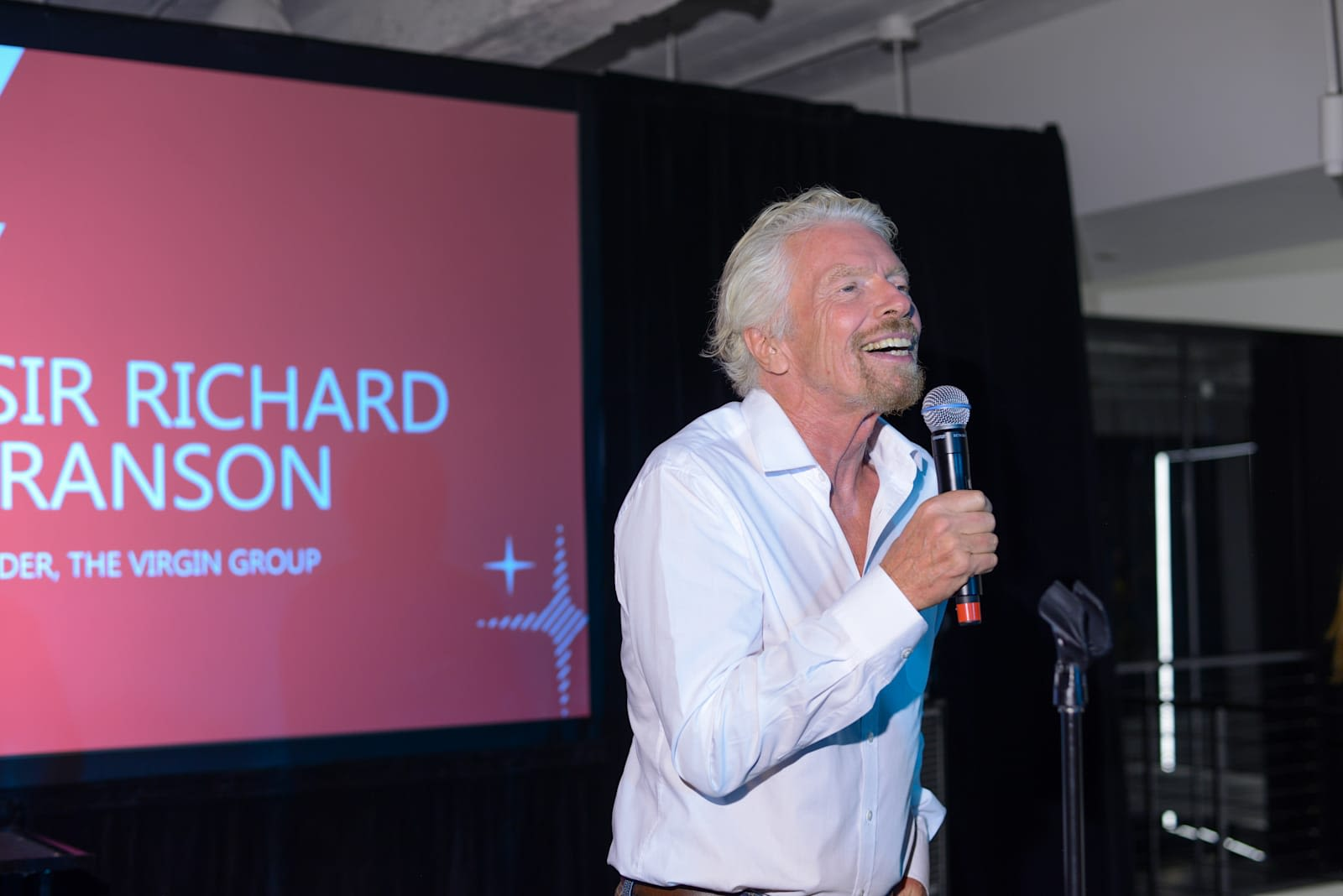 Richard Branson speaking at Virgin Unite's 15th anniversary celebration