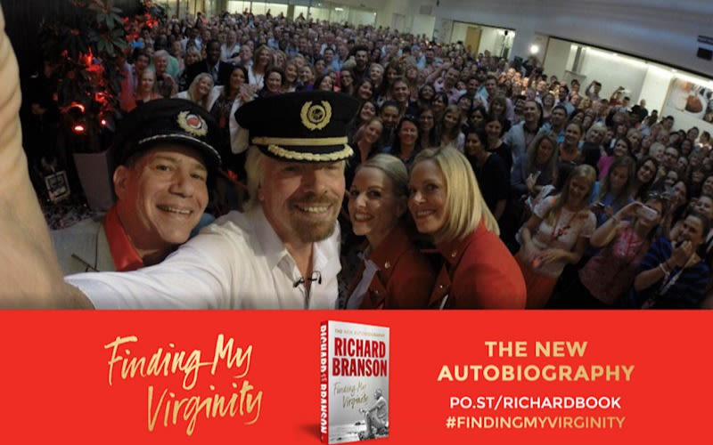 Richard Branson selfie with group with Finding My Virginity banner