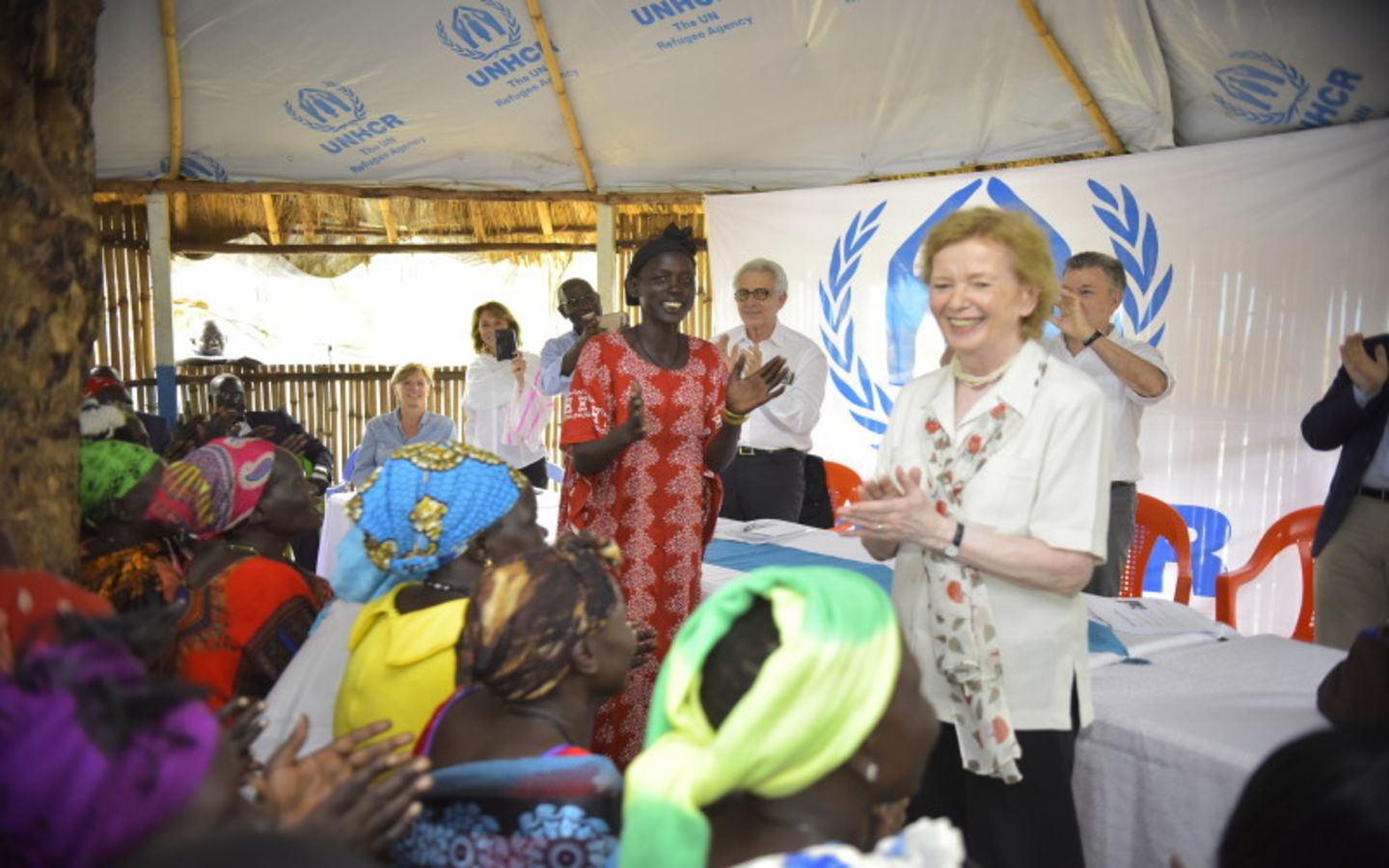Mary Robinson with refugees in Ethiopia in UNHCR tent