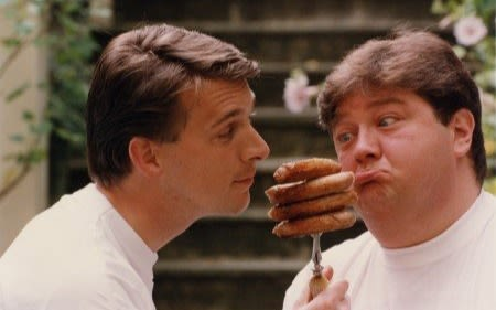 Virgin Radio presenters holding up a fork of BBQ sausages