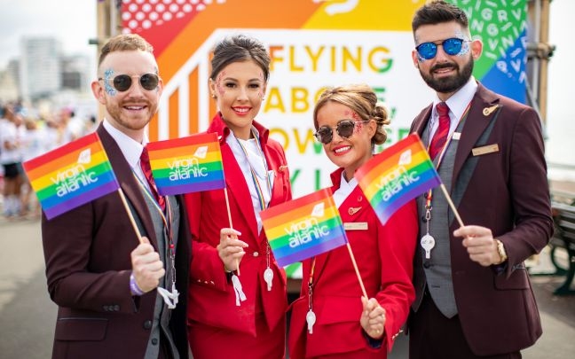 Virgin Atlantic employees hold Virgin Atlantic pride flags