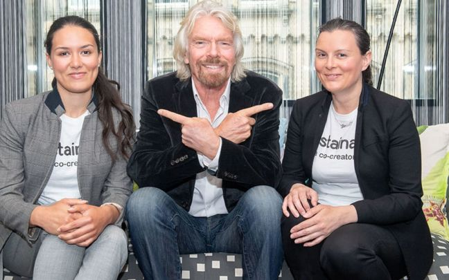 Richard Branson with the founders of the Sustainably app