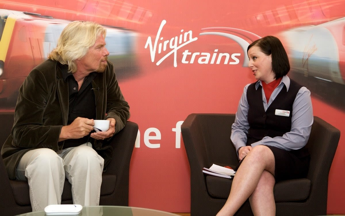 Richard Branson having a cup of tea at a Virgin Trains event in 2015