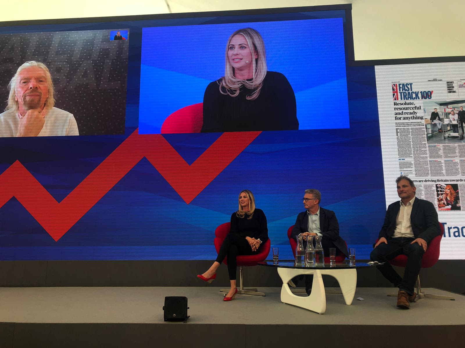 Richard Branson and Holly Branson on a pane at FastTrack 2019