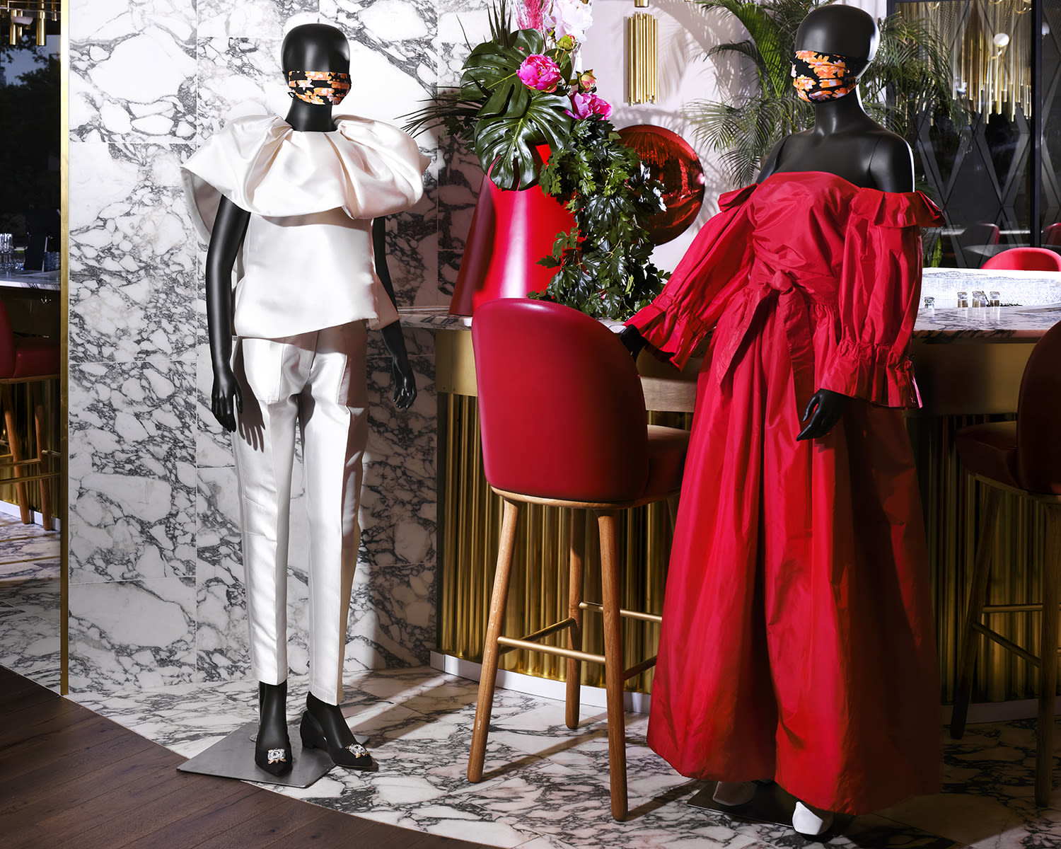 Two mannequins wearing facemasks at Virgin Hotels Dallas