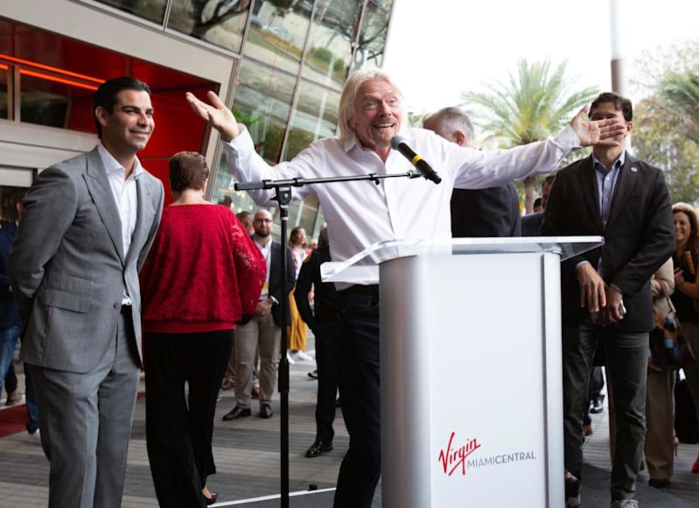 Richard Branson speaks at a podium for the launch of Virgin MiamiCentral