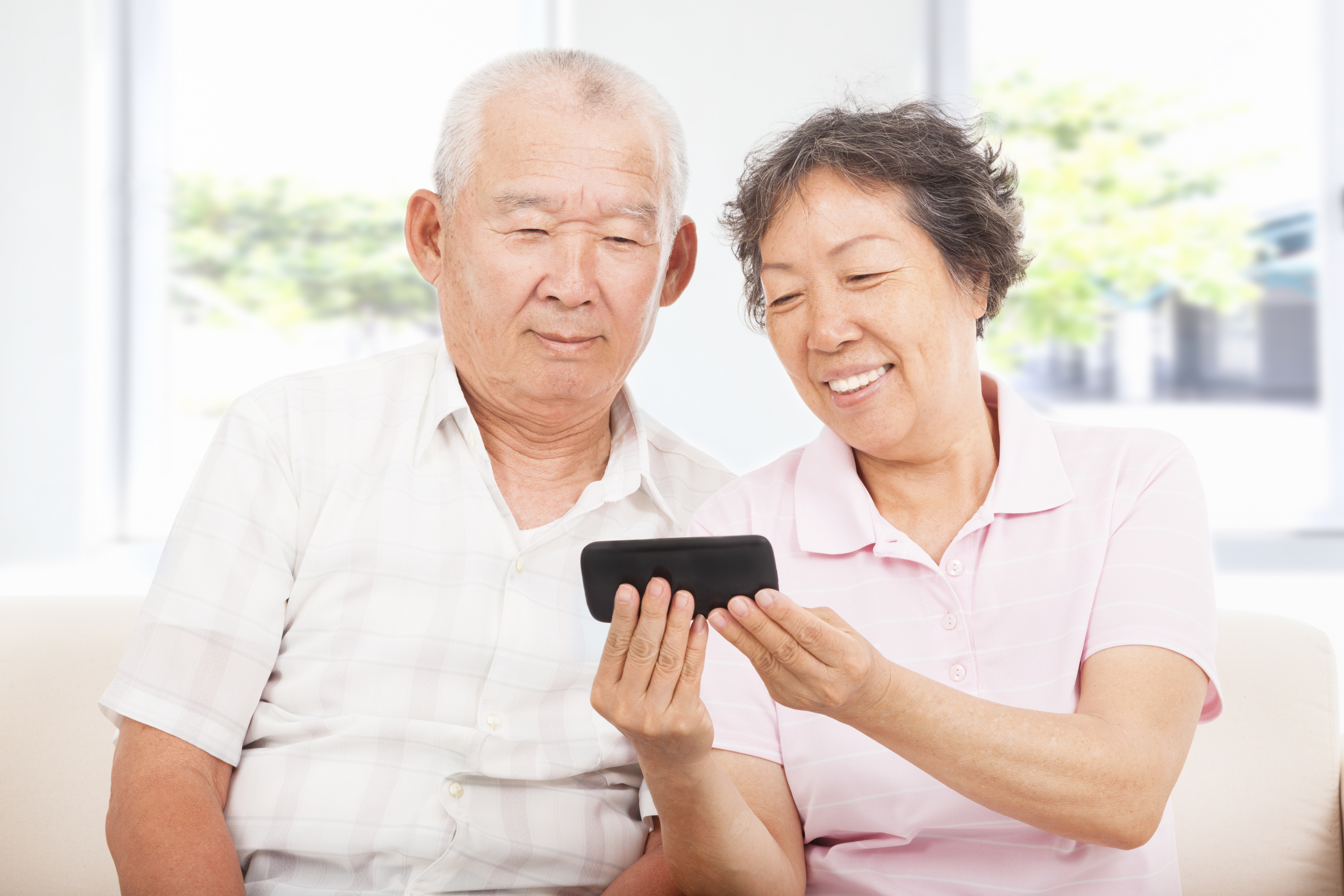 seniors looking at smartphone