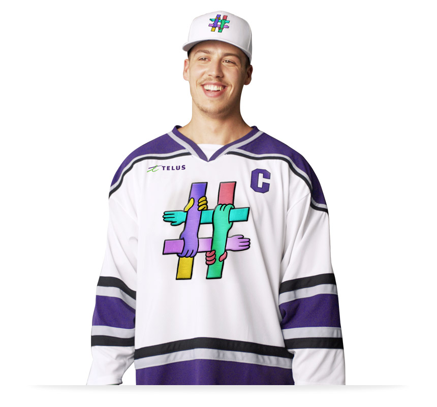 Maxime Comptois wearing a hockey jersey with a TELUS EndBullying logo on it