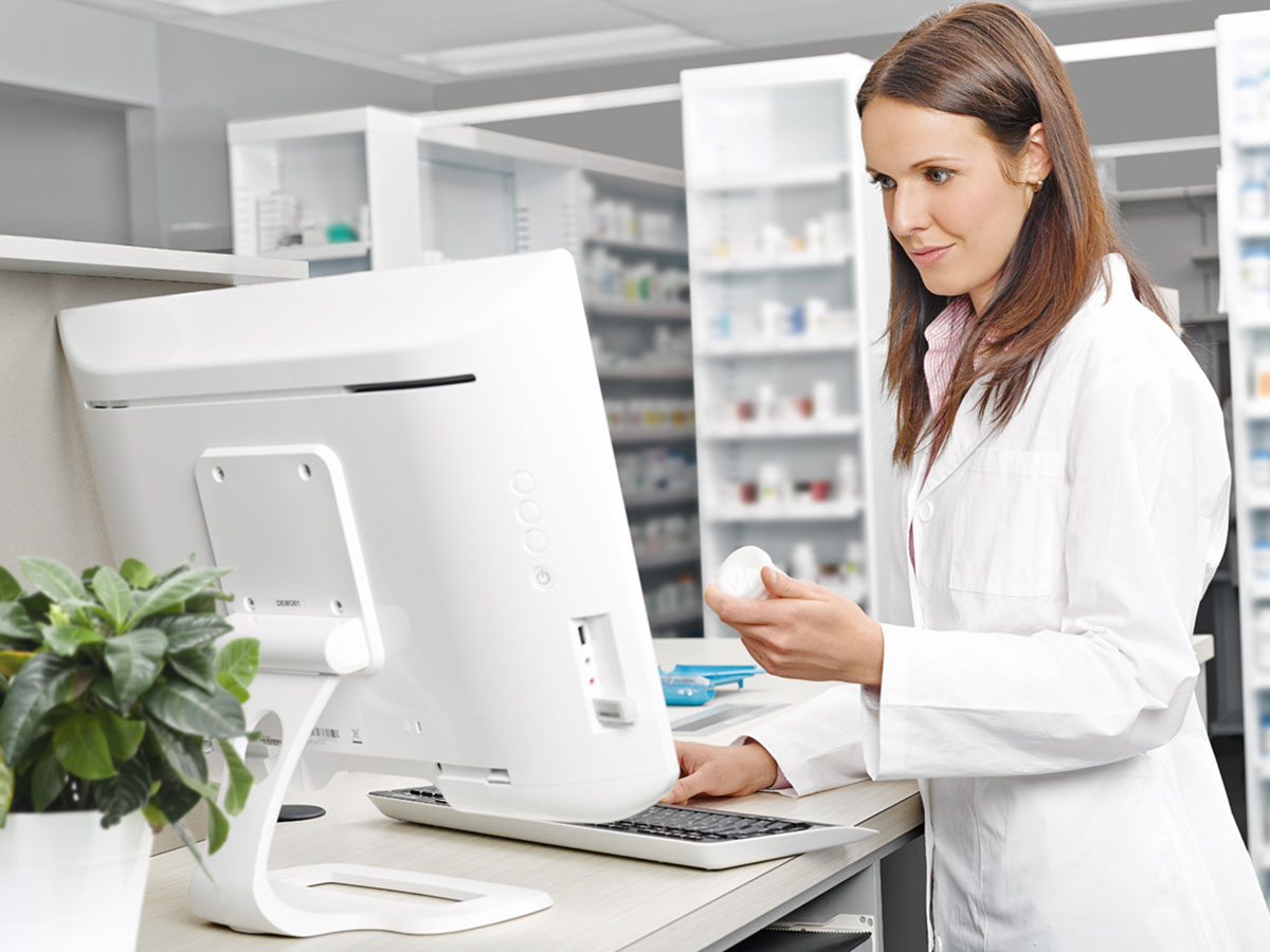 Pharmacist working on computer