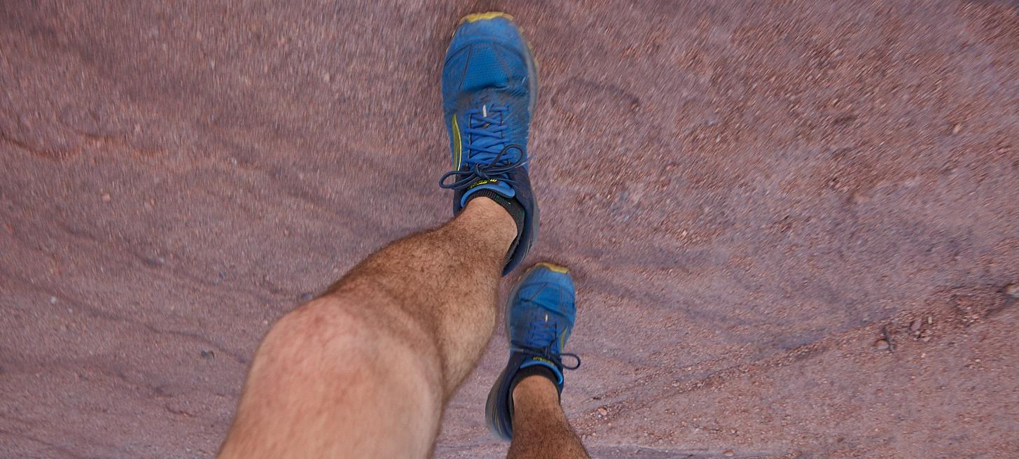 Legs running on the Dakota Ridge trail near Denver, CO for Native Roots Cannabis Co.