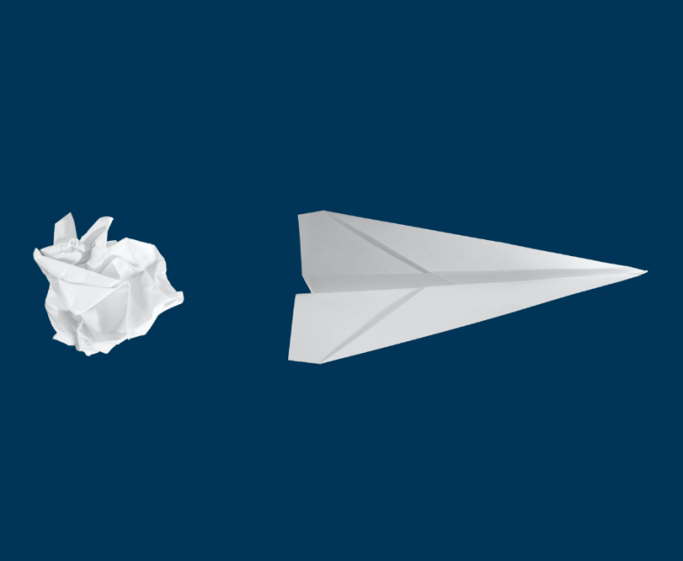 Scrunched up paper and a paper plane  by Matt Ridley