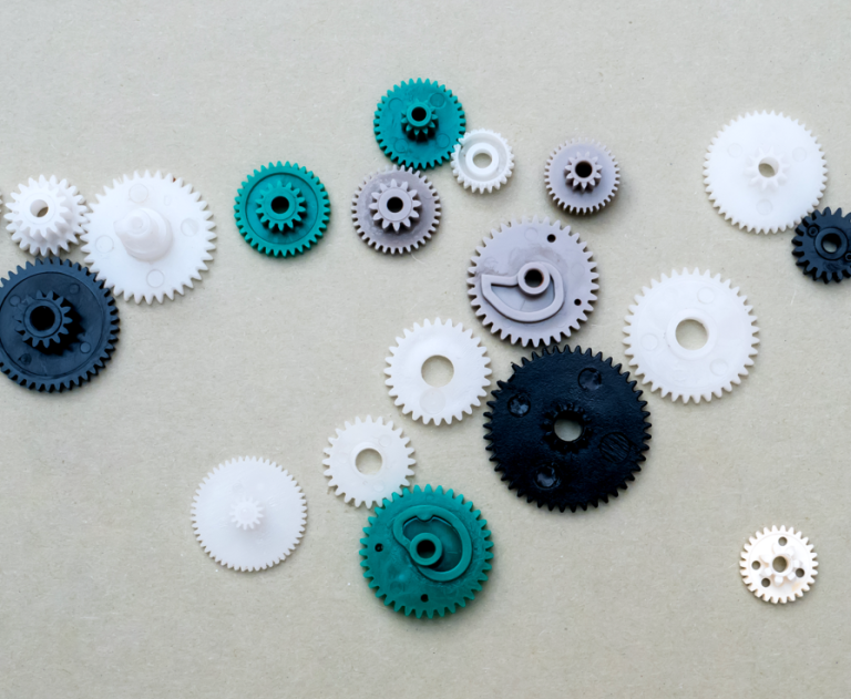 A collection of colored cogs connected in various ways.