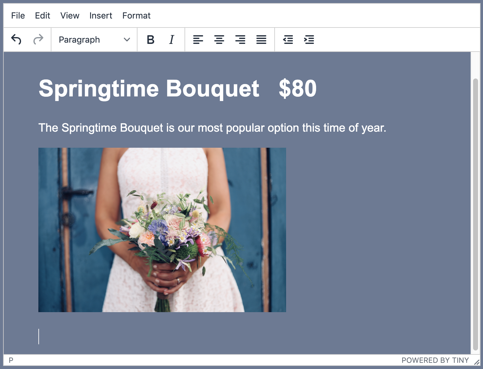 Screenshot of TinyMCE editor with an image of a wedding bouquet and non-cursive text reading
