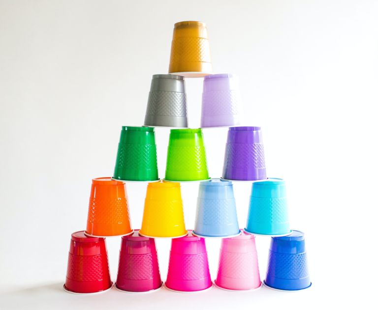 A stack of colored plastic cups, each a different color, forming a pyramid.