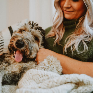 Image of a woman snuggling with her dog